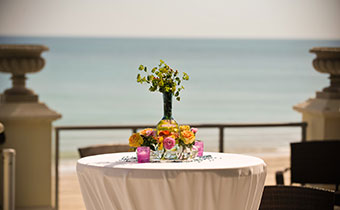 Cocktail Table Overlooking The Ocean Shoreline
